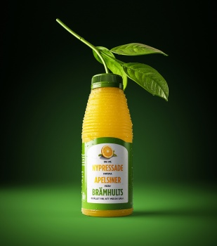 One bottle of orange juice from brämhults with leaf ant branch, fresh fruit citrus. Apelsin löv kvist