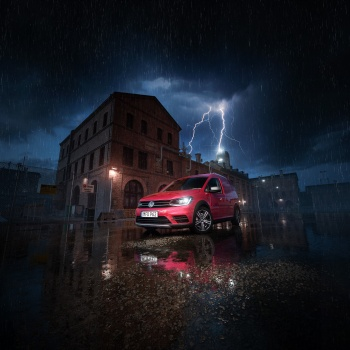 Volkswagen Caddy everything rack car in the industrial area of thunderstorms and rain